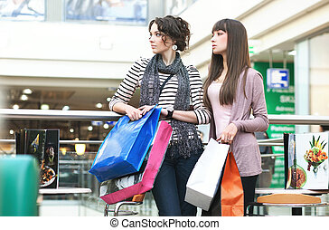 Attractive girls in shoppingcenter