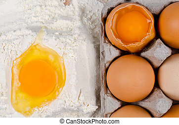 Recipe ingredients - Detail of egg yolk on flour