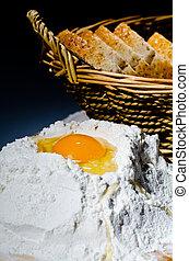 Recipe - Detail of egg yolk on flour