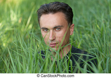 Mans portrait in the grass - Mans portrait in the green...