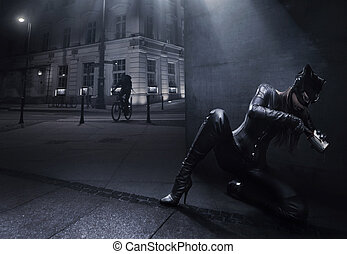Catwoman hunting on the night city background