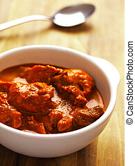 close up of a bowl of indian mutton curry