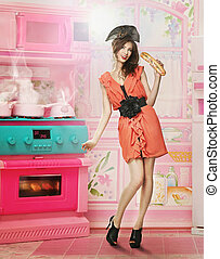 Doll like woman in doll house kitchen