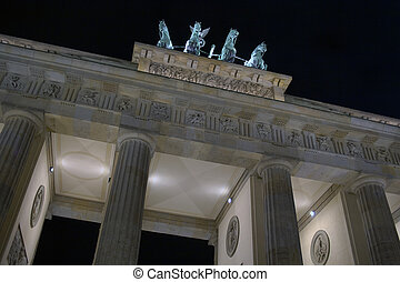 The famous Brandenburg gate in Berlin at night