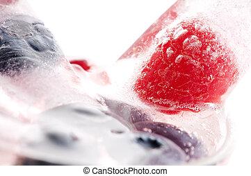 Raspberry and blackberry frozen in ice sticks