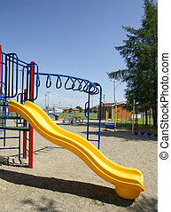 Yellow slide and fun playground equipment - Great fun at the...