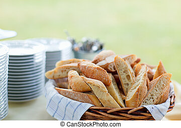 Group catering - Bread and stack of plates for group...