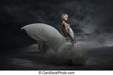 Young beauty woman wearing gorgeous dress standing over dark...