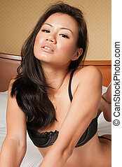 Singaporean woman - Pretty young Singaporean woman in skimpy...