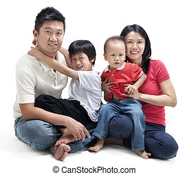Happy Asian family sitting on white background