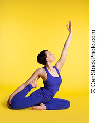 woman doing yoga pose - sit in blue on yellow