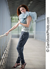 Young girl posing in a covered walkway