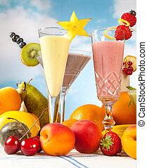 Fruit smoothies - Pastel colored fruit smoothies against a...