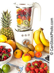 Blender and fruit - Abundance of fruit around a blender for...