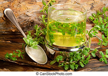herbal healing tea from Brahmi on a wooden background