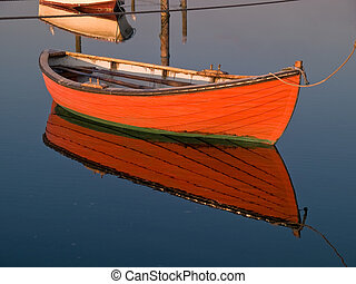 Small dinghy dory floating in the water - Small classical...