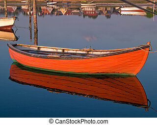 Reflection of a small dinghy dory boat - Small classical...