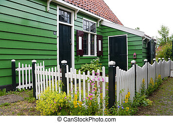 wooden fence - white wooden picket fence next to a...