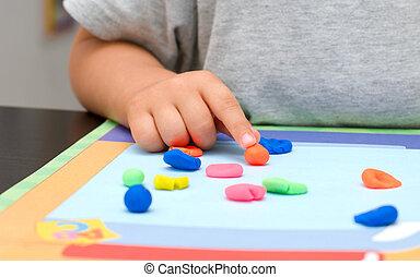 Plasticine - Baby hand and colored plasticine