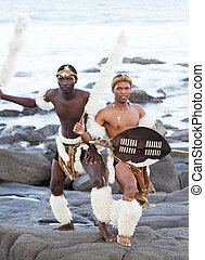 african zulu man on beach - african zulu man posing on beach