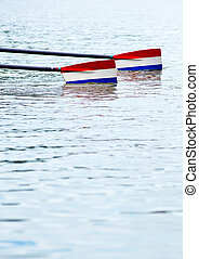 Rowing oars - Two rowing oars with red, white and blue...