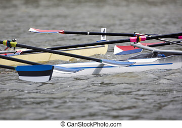 Rowing boat collision - Entangled oars and blades after a...