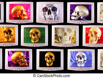Monitors with silvery or golden skulls on black background
