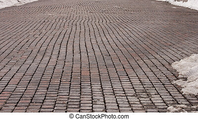 Brick Road - Old wet brick road in winter