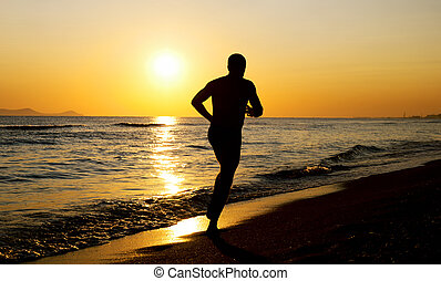 Running man - Silhouette of a running man on the beach