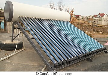 Vacuum solar water heating system on the house roof
