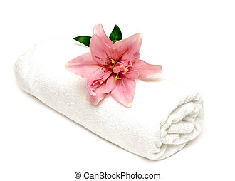 lily and towel on a white background