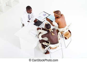 african businessman consulting - overhead view of a modern...
