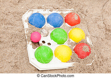 Bocce balls - Colorful set of the bocce balls on sand.