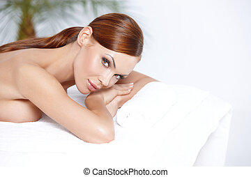 Lying on spa bed