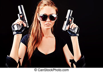 guns - Shot of a sexy military woman posing with guns