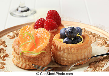 Puff pastries with custard and fruit - Puff pastry shells...