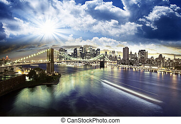 Clouds over Brooklyn Bridge in New York City, USA
