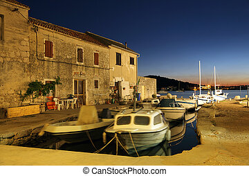 Fishing boats in Croatian town Murter at night