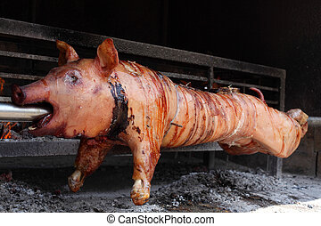 Roast pig on a barbecue