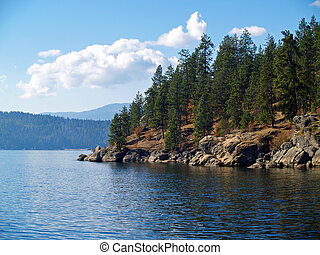 A Mountain Lake Under a Deep Blue Sky Coeur dAlene Idaho USA...