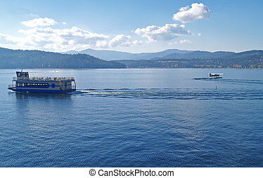 A Mountain Lake with a Cruise Ship and Water Plane - Coeur...