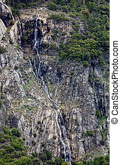 Long spidery cliff waterfall