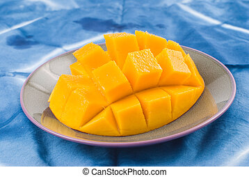 Fresh delicious mango fruit in dish