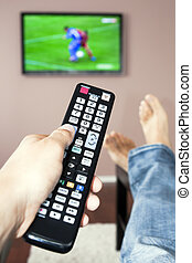 Men with the remote control, front of the television. -...