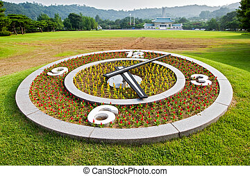 Flower clock on lawn background at Seoul National Cemetery