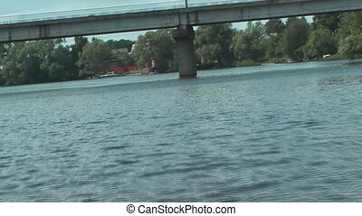 Motorboat. - View of the river bank with a motor boat.