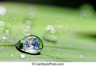 drop and earth - photo montage where the earh is inside a...
