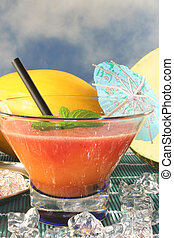 Melon smoothie - a glass of melon smoothie with fresh...