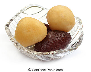 Close up of sweetmeats over white background