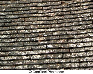Tile roof background - multi coloured old looking tile roof...